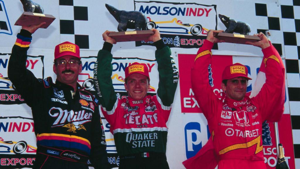 The Toronto podium, with Bobby Rahal, winner Adrian Fernandez, and Alex Zanardi. (Image: LAT Photographic)